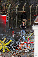 Pictured: Migrants gather behind the barb wired border. Sunday 01 March 2020<br /> Re: Clashes between migrants and riot police at the Greek-Turkish border of Kastanies near Evros, Greece