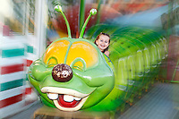 A pretty little girl having fun with roller coaster
