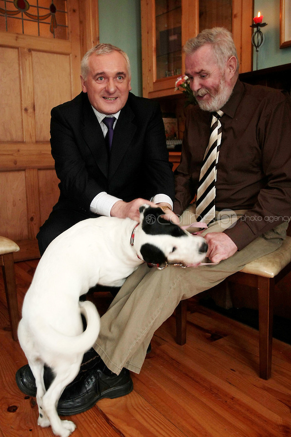 5/11/07 Taoiseach Bertie Ahern with Tommy Gilsanen and Dancer the dog at the opening of Peter Bradley Foundation Residential Home.at 153 Mobhi Road, Glasnevin, Dublin Picture:Arthur Carron/Collins