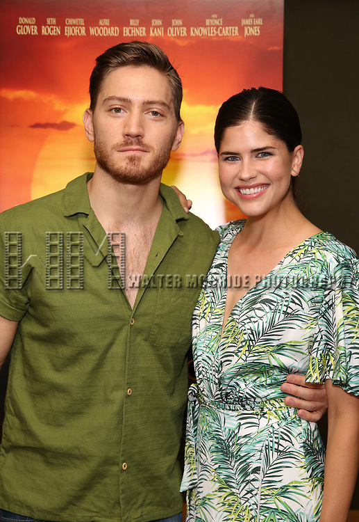 """Adam Jepson and guest attends the Broadway screening of the Motion Picture Release of """"The Lion King"""" at AMC Empire 25 on July 15, 2019 in New York City."""