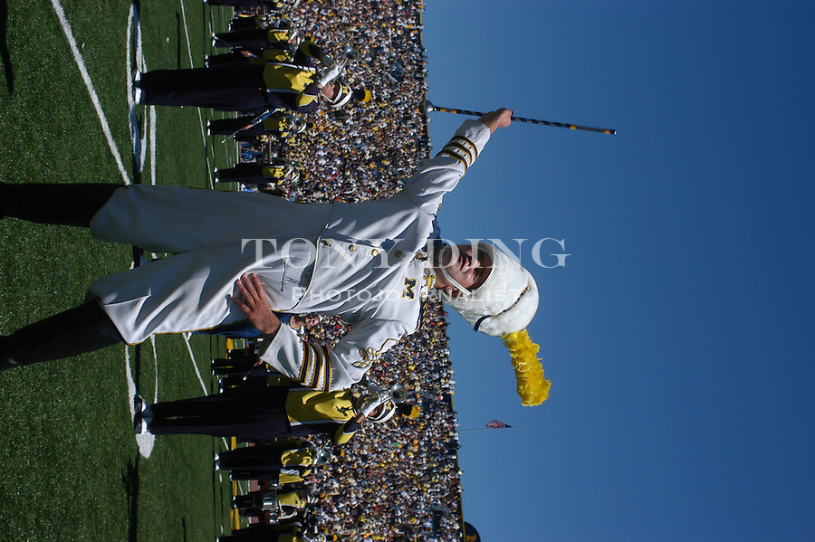 Engineering Senior Matt Cavanaugh twirls his baton on the Big House field in his second year as Drum Major for the Michigan Marching Band during the Wolverine's 45-7 crushing of Central Michigan at Michigan's first game of the season on Saturday, August 30, 2003 in Michigan Stadium in Ann Arbor, Mich. (TONY DING/The Michigan Daily).