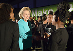 Hillary Rodham Clinton greets members of Summer of Sisterhood, a musical group from the Westside Community House in Cleveland, Ohio, just before the former first lady spoke to participants in the United Methodist Women's Assembly during an April 26, 2014 worship service at the Kentucky International Convention Center in Louisville, Kentucky. Clinton is a lifelong member of United Methodist Women.