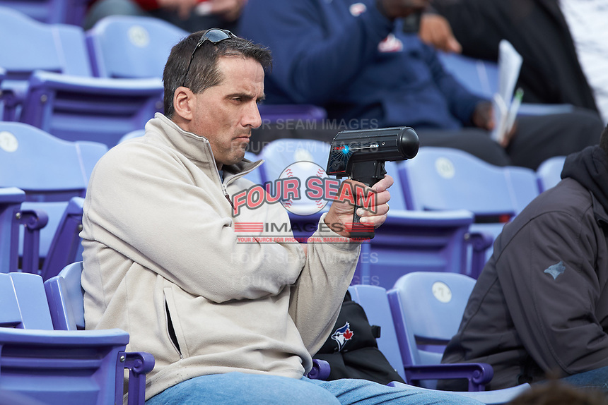 A scout uses a radar gun as he watches the Big South baseball game between the Campbell Camels and the High Point Panthers at Williard Stadium on March 16, 2019 in  Winston-Salem, North Carolina. The Camels defeated the Panthers 13-8. (Brian Westerholt/Four Seam Images)