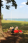 A woman reads a book at North Avenue beach in Chicago, Illinois on August 18, 2008.