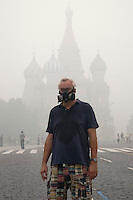 Moscow, Russia, 07/08/2010. .A man in Red Square wears an industrial gas mask in the worst smog so far in the record high temperatures of the continuing heatwave. Peat and forest fires in the countryside surrounding Moscow have resulted in the Russian capital being blanketed in heavy smog.