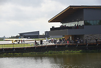 NWA Democrat-Gazette/FLIP PUTTHOFF <br />Visitors on Saturday Oct. 6 2018 take in the grand opening of Thaden Fieldhouse at the Bentonville airport, with Lake Bentonville in the foreground. The fieldhouse, along Southwest I Street, features an exhibit hangar, porches that overlook the runway, a cafe and retail shop. It is also home of the OZ1 Flying Club.