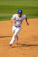 Stuart Turner (30) of the Chattanooga Lookouts runs during a game between the Jackson Generals and Chattanooga Lookouts at AT&T Field on May 10, 2015 in Chattanooga, Tennessee. (Brace Hemmelgarn/Four Seam Images)