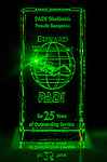 22 December 2013: Laser light illuminates a crystal engraved PADI 25 Year Award, given to Edwards Wolfstein, PADI OWSI 200262 in 2009. Edward Wolfstein became a PADI Open Water Scuba Instructor in 1984, crossing over from NASDS., where he earned his OWSI 1691 at the Newport Rhode Island Clinic in 1978. Mandatory Credit: Ed Wolfstein Photo *** RAW (NEF) Image File Available ***