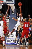 21 January 2012:  FIU guard-forward Dominique Ferguson (3) attempts to put up a basket in the first half as the Florida Atlantic University Owls defeated the FIU Golden Panthers, 66-64, at the U.S. Century Bank Arena in Miami, Florida.