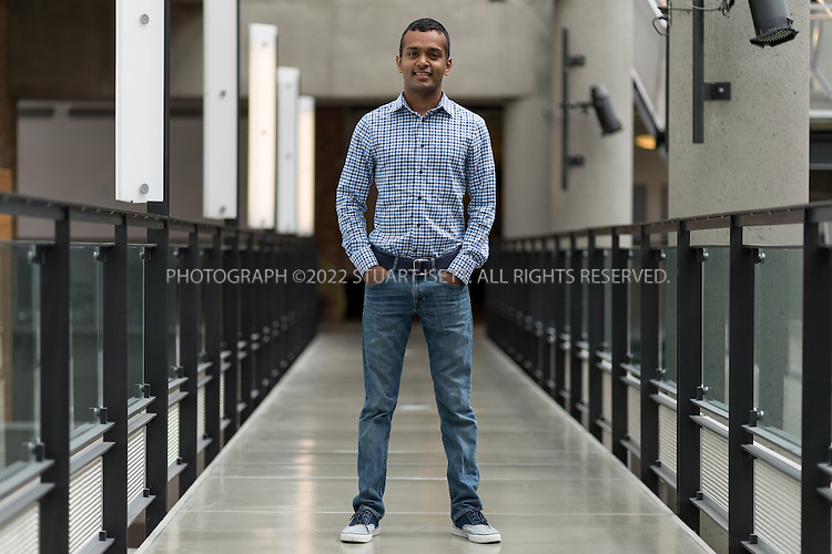 8/28/2013--Seattle, WA, USA<br /> <br /> Shyamnath Gollakota, 28, assistant professor at the Department of Computer Science and Engineering Networks and Wireless Lab at the University of Washington, posing in the Paul G. Allen Center where his lab is located.<br /> <br /> Gollakota is working on &quot;battery-free devices that communicate with each other, without either device generating radio signals of their own. Instead these devices implement a new technique called ambient backscatter that uses existing wireless signals from TV stations to both power the device and communicate by reflecting the TV signals&quot; (SOURCE: Shyamnath Gollakota). <br /> <br /> <br /> &copy;2013 Stuart Isett. All rights reserved.