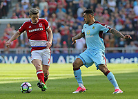 Burnley's Andre Gray tries to get round Middlesbrough's Grant Leadbitter<br /> <br /> Photographer David Shipman/CameraSport<br /> <br /> The Premier League - Middlesbrough v Burnley - Saturday 8th April 2017 - Riverside Stadium - Middlesbrough<br /> <br /> World Copyright &copy; 2017 CameraSport. All rights reserved. 43 Linden Ave. Countesthorpe. Leicester. England. LE8 5PG - Tel: +44 (0) 116 277 4147 - admin@camerasport.com - www.camerasport.com