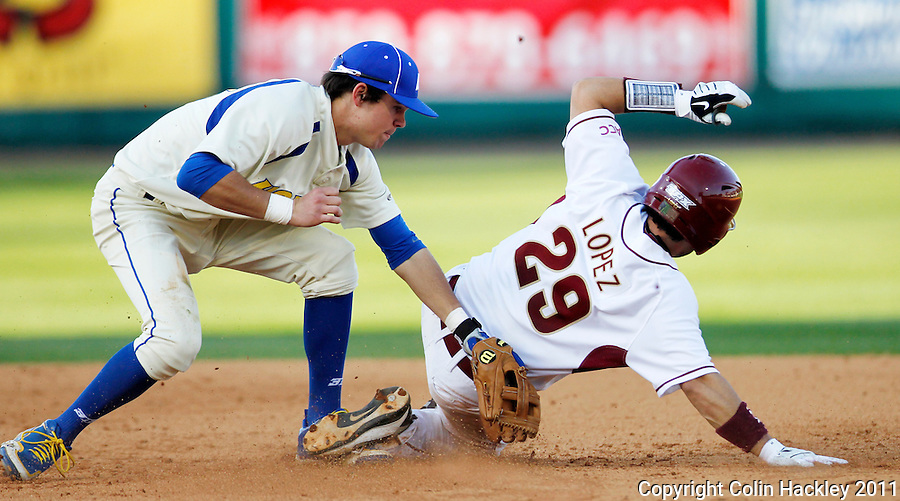 TALLAHASSEE, FL 2/26/11-FSU-HOFSTRA BASE11 CH-Florida State's Rafael Lopez slides by Hofstra's Logan Davis to be safe at second during fifth inning action Saturday at Dick Howser Stadium in Tallahassee. The Seminoles beat the Pride 16-3...COLIN HACKLEY PHOTO