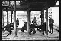 Local residents play Chinese chess along the ancient Beijing-Hangzhou Grand Canal in Hangzhou, Zhejiang province, China, March 2013.