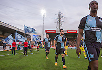 The Players head on the pitch during the Sky Bet League 2 match between Wycombe Wanderers and Oxford United at Adams Park, High Wycombe, England on 19 December 2015. Photo by Andy Rowland.