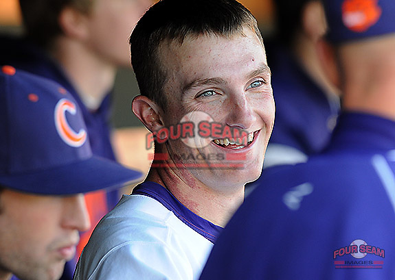 Starting pitcher Matthew Crownover (44) of the Clemson Tigers smiles in the dugout after pitching in a game against the Wofford Terriers on Wednesday, March 6, 2013, at Doug Kingsmore Stadium in Clemson, South Carolina. Clemson won, 9-2, with freshman Crownover picking up his first win.