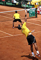 CALI – COLOMBIA – 05-04-2014: Juan Sebastian Cabal y Robert Farah de Colombia en accion contra Victor Estrella y Jose Hernandez de Republica Dominicana durante el dia dos de partidos en el Grupo I de la Zona Americana de la Copa Davis, partidos entre Colombia y República Dominicana en Estadio de Tenis Alvaro Carlos Jordan en la ciudad de Cali. / Juan Sebastian Cabal and Robert Farah of Colombia in action against Victor Estrella and Jose Hernandez of the Dominican Republic during day two in matches for the Group I of the American Zone Davis Cup, between Colombia and the Dominican Republic, at the Carlos Alvaro Jordan, Tennis  Stadium in the city of Cali. Photo: VizzorImage / Luis Ramirez / Staff.