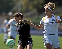 Tina DiMartino (5) controls the ball against Lisa Sari (12). Los Angeles Sol defeated FC Gold Pride 2-0 at Buck Shaw Stadium in Santa Clara, California on May 24, 2009.