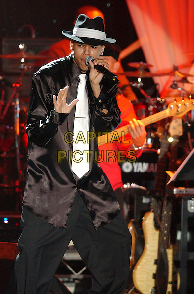 CHRIS BROWN.2006 Clive Davis Pre-GRAMMY Party sponsored by L'Oreal, Rhapsody, and XM Satellite Radio held at the Beverly Hilton Hotel, Beverly Hills, California, USA..February 6th, 2006.Photo: Laura Farr/AdMedia/Capital Pictures.Ref: LF/ADM.full length stage music live gig performance black hat trousers white tie singing.www.capitalpictures.com.sales@capitalpictures.com.© Capital Pictures.