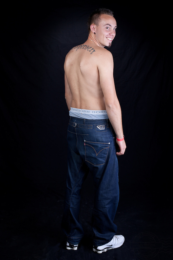 Young danish man with lettering on upper back.<br /> From the Kolding Tattoo Convention.