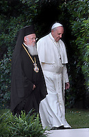Pope Francis arrives with Palestinian leader Mahmud Abbas  and Israeli President Shimon Peres and Orthodox Patriarch Bartholomew,Custos of the Holy Land Fr. Pierbattista Pizzaballa.for a joint peace prayer in the gardens of the Vatican.June 8, 2014