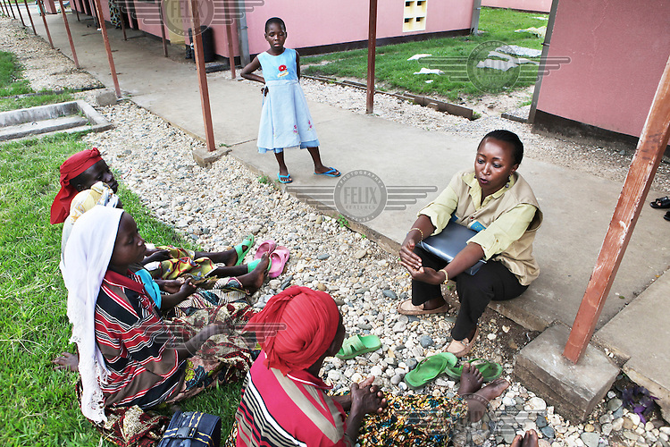 Women waiting to receive a fistula operation in the University Hospital of Kamenge in Bujumbura. Women with fistula, a hole in the birth canal, smell of leaking urine and are often socially excluded from their community. Left untreated, fistula can lead to chronic medical problems, including ulcers and kidney disease. A simple surgical procedure can normally repair the injury, but the problem in Burundi is that there is no-one trained to perform the operation. These women's operation was possible thanks to an initiative of Handicap International and Gynecologie Sans Frontieres.