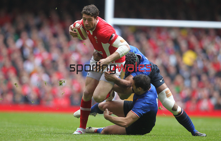 Alex Cuthbert crashes into Thierry Dusautoir and Florian Fritz..RBS 6 Nations 2012.Wales v France.Millennium Stadium.17.03.12..CREDIT: STEVE POPE-SPORTINGWALES