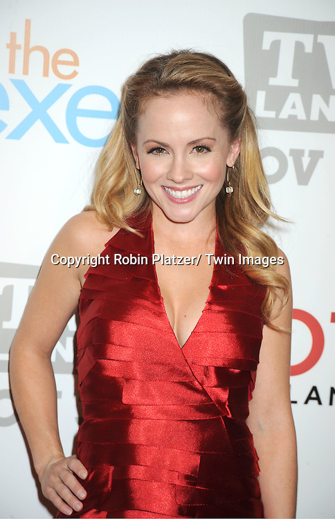 "Kelly Stables in red BeBe dress attends the TV Land Party for the  premieres of ""Hot In Cleveland"" and ""The Exes""  on November 29, 2011 at SD26 in New York City. the party also celebrated Toys for Tots."