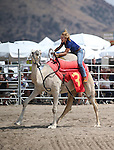 Wendy Damonte competes in a media exhibition race at the 56th annual International Camel &amp; Ostrich Races in Virginia City, Nev. on Friday, Sept. 11, 2015. <br /> Photo by Cathleen Allison