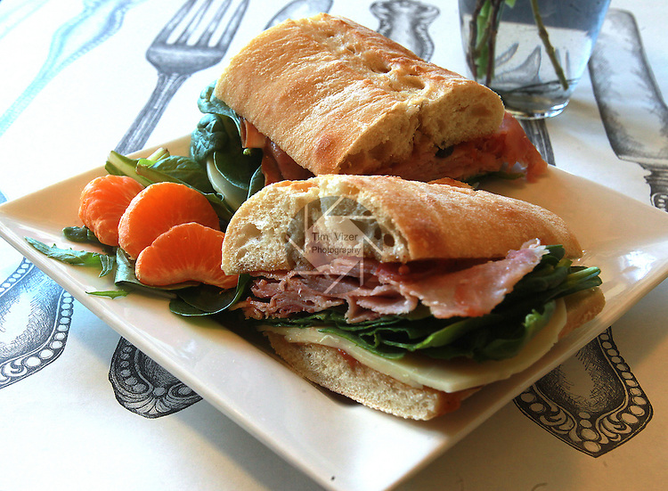 "The ""Oliver Twist"" ham sandwich at Fezziwig's Charles Dickens Tea Room & Cafe' in Lebanon. Owner Ellen Leaf-Moore describes the sandwich as a ""twist"" on a regular ham sandwich -- it's seasoned with farmhouse chutney - a savory condiment used throughout Europe and the UK, which is making it's way into American use.  Slices of clementine on spinach leaves are a colorful and tasty complement to the sandwich."