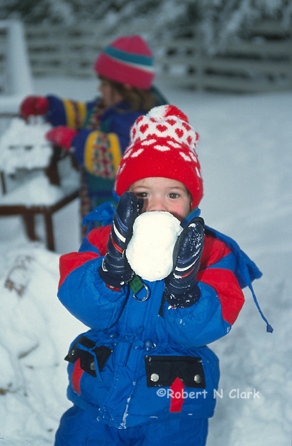 Boy with snow ball