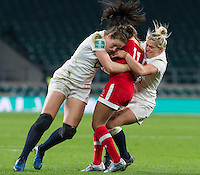 Emily Scarratt and Rachael Burford tackle Magali Harvey, England Women v Canada Women in an Old Mutual Wealth Series, Autumn International match at Twickenham Stadium, London, England, on 26th November 2016. Full time score 39-6