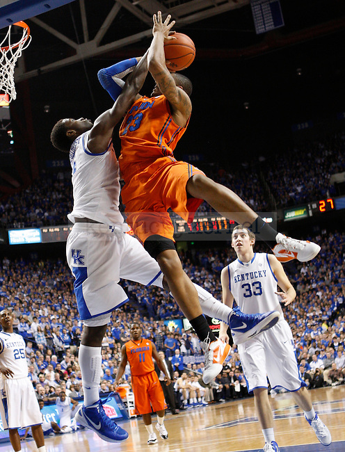 UK forward Michael Kidd-Gilchrist attempts to block Florida's Bradley Beal's shot during the second half of the University of Kentucky Men's basketball game against University of Florida on 2/7/12 in Lexington, Ky. Photo by Quianna Lige | Staff