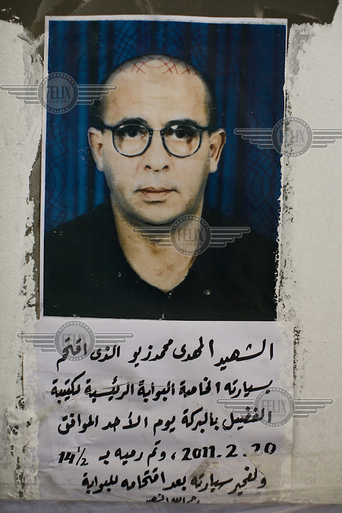 A photograph of a missing man with an inscription in Arabic placed outside the central courthouse in Benghazi. The courthouse has become a focal point for relatives of people who have gone missing in Libya in recent years and during the 2011 civil war. Many relatives bring photographs of their missing family members and leave them outside the courthouse. ..