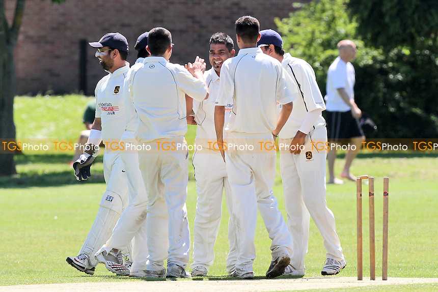J Sorrell of Hornchurch is bowled out by S Akbar who celebrates with his team mates - Hornchurch CC vs Loughton CC - Essex Cricket League at Harrow Lodge - 26/05/12 - MANDATORY CREDIT: Gavin Ellis/TGSPHOTO - Self billing applies where appropriate - 0845 094 6026 - contact@tgsphoto.co.uk - NO UNPAID USE.