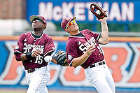 June 11, 2011:   Mississippi State Bulldogs inf/of Nick Vickerson (21) almost collides with outfielder Jaron Shepherd (15) after catching a fly ball during NCAA Gainesville Super Regional Game 2 action between Florida Gators and Mississippi State Bulldogs played at Alfred A. McKethan Stadium on the campus of Florida University in Gainesville, Florida.   Mississippi State defeated Florida 4-3.........