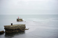 pink fisherman &amp; his bike in the Irish sea next to the course<br /> <br /> Giro d'Italia 2014<br /> stage 2: Belfast-Belfast <br /> 219km