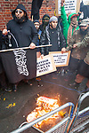 "© Joel Goodman - 07973 332324 - all rights reserved . 11/11/2010 . London , UK . MOHAMMED REZA HAQUE (aka "" Giant "") (left) . Muslims Against Crusades hold a demonstration and burn a poppy on the anniversary of Armistice Day , at Kensington Gore , opposed by a demonstration of nationalist groups including the English Defence League ( EDL ) . Photo credit : Joel Goodman"