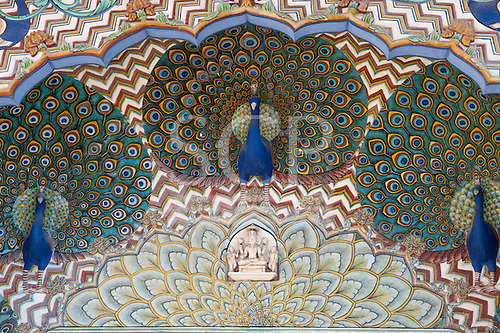 Jaipur, India. The  City Palace Pritam Niwas Chowk courtyard; detail of the Northwest gate, dedicated to Lord Vishnu with carved and painted detail of peacocks. Vishnu is represented in marble.