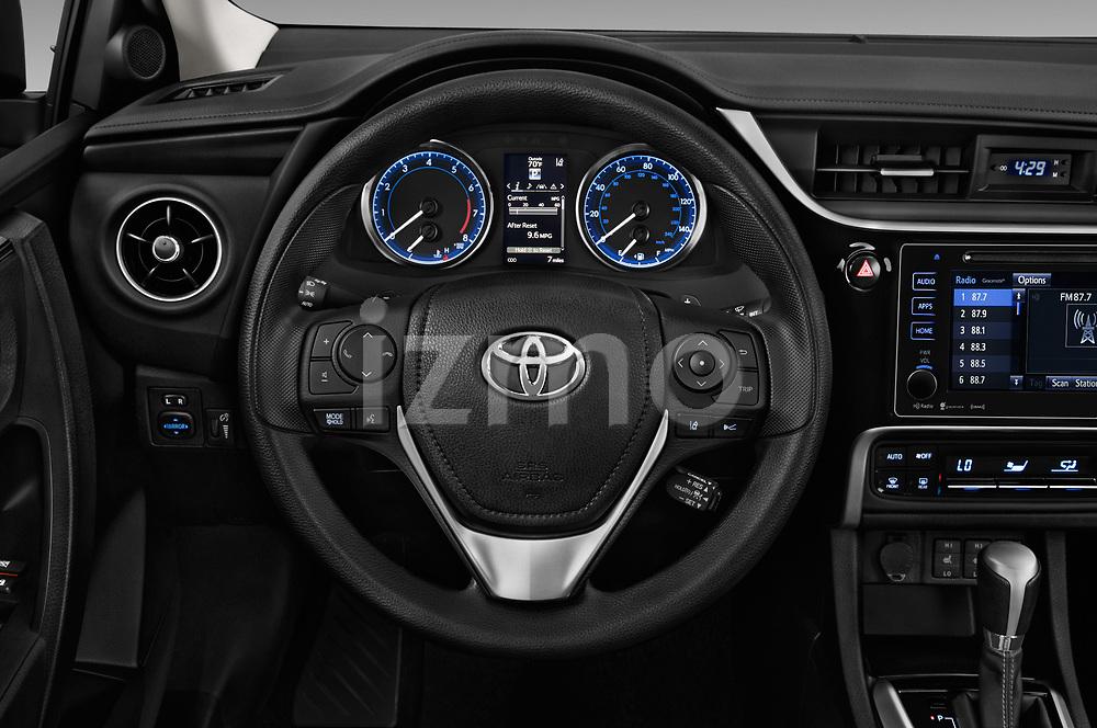 Car pictures of steering wheel view of a 2017 Toyota Corolla XLE Premium 4 Door Sedan