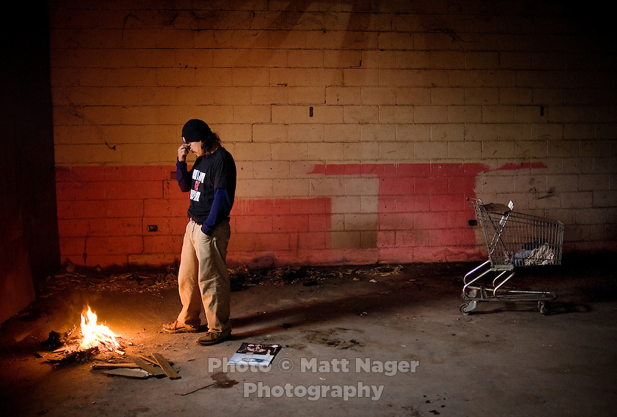 Ricardo Vega (cq, age 28), an immigrant from Mexico who speaks little English and has had trouble finding work makes a fire for warmth in an abandoned cantina in Laredo, Texas, US, Friday, Dec., 11, 2009. With over 95 percent of the population as Hispanic Spanish speakers, Laredo ranked the lowest in literacy rates in the 2000 US census. Today there are a number of bi-lingual and dual langauge classes set up to help students and adults learn english...PHOTOS/ MATT NAGER