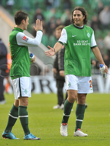 Bremen's Mesut Ozil (L) and Claudio Pizarro (R) shake hands after the German Bundesliga match Werder Bremen v TSG Hoffenheim at Weser stadium in Bremen, Germany, 17 October 2009. Bremen won the match 2-0. Photo: CARMEN JASPERSEN