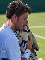London, England, 27 june, 2016, Tennis, Wimbledon, Robin Haase (NED) wipes his head during changeover in his match against Diego Swartzman (ARG)<br /> Photo: Henk Koster/tennisimages.com