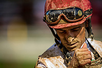 SARATOGA SPRINGS, NY- AUGUST 04: John Velazquez blows dirt from his nose after a race at Saratoga Racecourse on August 4, 2018 in Saratoga Springs, New York.(Photo by Alex Evers/Eclipse Sportswire)