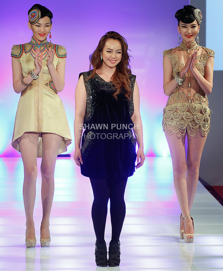 Mongolian fashion designer Otgonjargal Demberelsuren walks runway with models at the close of her Otgoo Couture collection fashion show, during Couture Fashion Week Fall 2014, on February 14, 2014.