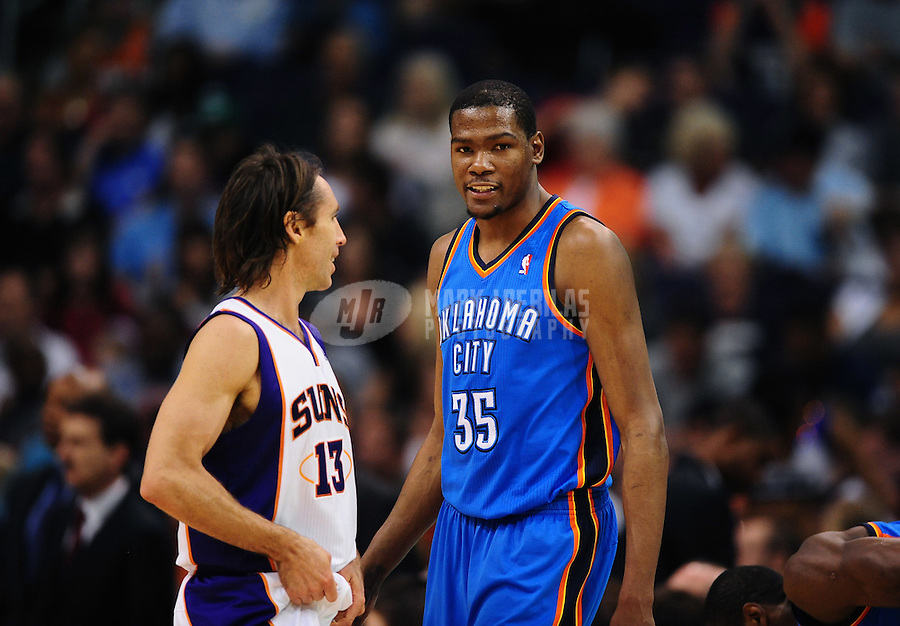 Mar. 30, 2011; Phoenix, AZ, USA; Oklahoma City Thunder forward (35) Kevin Durant greets Phoenix Suns guard Steve Nash at the US Airways Center. Mandatory Credit: Mark J. Rebilas-