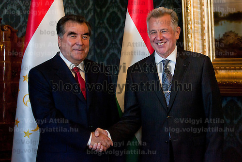 President of Tajikistan Emomali Rahmon (L) shakes hands with his Hungarian counterpart Pal Schmitt (R) have a sight-viewing together in Budapest, Hungary on June 10, 2011. ATTILA VOLGYI.Emomali Rahmon is in Hungary fro a two-day official visit.