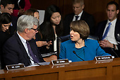Sheldon Whitehouse, Democrat of Rhode Island, and Senator Amy Klobachar, Democrat of Minnesota, speak during the confirmation hearing of Judge Brett Kavanaugh before the United States Senate Judiciary Committee on his nomination as Associate Justice of the US Supreme Court to replace the retiring Justice Anthony Kennedy on Capitol Hill in Washington, DC on Tuesday, September 4, 2018.Credit: Alex Edelman / CNP