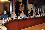Egypt's interim President Adly Mansour (L, in suit and tie) meets with Egypt's army chief Field Marshal Abdel Fattah al-Sisi (seated next to Mansour) and military leaders, in Cairo March 26, 2014. Egypt's military leadership was presenting Field Marshal Abdel Fattah al-Sisi's resignation from his post of defence minister at a meeting with the interim head of state on Wednesday, the state-run Al-Ahram newspaper reported on its website. Sisi is required to step down from his positions in the military in order to mount a widely expected bid for the presidency, which he is forecast to win easily in a forthcoming election. apaimages/Military Moral Affairs