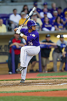 LSU Tigers third baseman Christian Ibarra #14 at bat during the Southeastern Conference baseball game against the Georgia Bulldogs on March 22, 2014 at Alex Box Stadium in Baton Rouge, La. The Tigers defeated the Bulldogs 2-1. (Andrew Woolley/Four Seam Images)