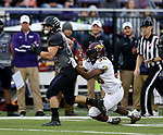 SIOUX FALLS, SD - SEPTEMBER 23: Max Mickey #22 from the University of Sioux Falls is brought down from behind by Omar Porte #36 from Minnesota Crookston in the first half of their game Saturday night at Bob Young Field in Sioux Falls. (Photo by Dave Eggen/Inertia)